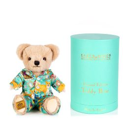 limited edition teddy bear dressed in silk Karen Mabon pyjamas in a turquoise corgi and other royal icons design