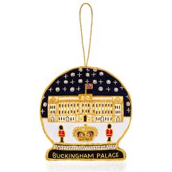 a snow globe shaped Christmas decoration depicting Buckingham Palace embroidered with gold threads and beads