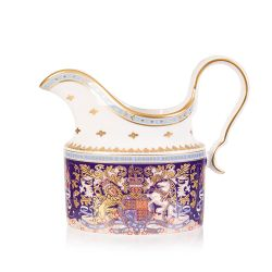 Longest reigning monarch milk jug. Oval shaped purple milk jug with an ornate crest and a white and gold spout and handle
