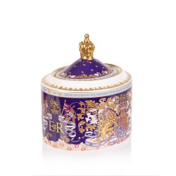 Longest reigning monarch sugar bowl. Oval shaped purple sugar bowl with an ornate crest and the lid has a gold crown