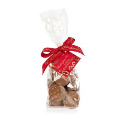 Mulled wine flavoured chocolates decorated with imprinted gold stars in a clear plastic bag with red ribbon stating 'Buckingham Palace' in gold writing.