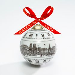 Christmas bauble depicting monument and landmarks in London including Royal Albert Hall, Westminster Abbey and Buckingham Palace. All illustrations are in black and white and the bauble is complete with a red bow