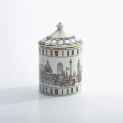 Fine bone English china candle pot depicting black and white sketches of London monuments including London eye, Big Ben and red phone box and red bus. The candle has a lid with a gold gilding edge.