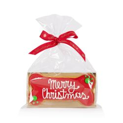 red dog bone shaped dog biscuit with the words 'Merry Christmas' piped onto the biscuit in white. Wrapped in a cellophane bag with a red 'Buckingham Palace' ribbon