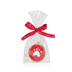 red circular dog biscuit with a white paw print on the front. Wrapped in a cellophane bag with a red Buckingham Palace ribbon