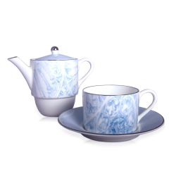 blue and white teapot and teacup and saucer