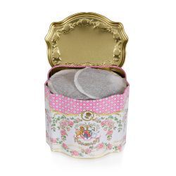 Open tea caddy printed with a pink rose floral design and a lion and unicorn rest at the centre.
