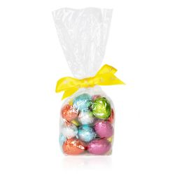 a bag of colourful foiled praline eggs in a clear bag and tied with a yellow 'Buckingham Palace' ribbon