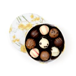 open circular box of different chocolate truffles