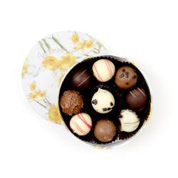 open circular box of different chocolate truffles