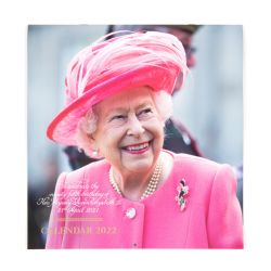 The front cover of a 2022 calendar to celebrate The Queen's 95th birthday. The Queen is on the front cover wearing a pink coat and hat.