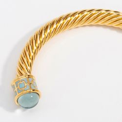 18ct gold plated twisted bracelet with aquamarine coloured glass on the end
