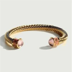 18ct gold plated twisted bracelet with rose quartz coloured glass on the end