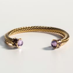 18ct gold plated twisted bracelet with amethyst coloured glass on the end