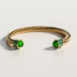 18ct gold plated twisted bracelet with emerald coloured glass on the end