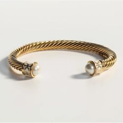 18ct gold plated twisted bracelet with cream coloured glass on the end