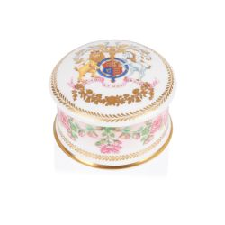 The design of this commemorative pillbox is wonderfully inspired by the pink roses in bloom at the time of The Queen's official birthday, on the East Terrace Garden, Windsor Castle. At the centre of the pillbox lid is a specially painted coat of arms whic