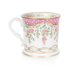 The design of this commemorative tankard is wonderfully inspired by the pink roses in bloom at the time of The Queen's official birthday, on the East Terrace Garden, Windsor Castle. At the centre of the tankard is a specially painted coat of arms which is