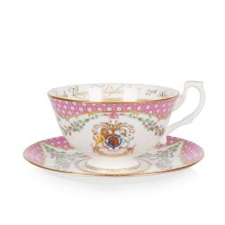 The design of this commemorative teacup and saucer is wonderfully inspired by the pink roses in bloom at the time of The Queen's official birthday, on the East Terrace Garden, Windsor Castle. At the centre of the teacup is a specially painted coat of arms