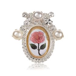 Crystal and pearl oval brooch with a printed pink rose at the centre