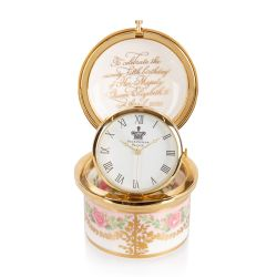The design of this limited edition pillbox clock is wonderfully inspired by the pink roses in bloom at the time of The Queen's official birthday, on the East Terrace Garden, Windsor Castle. The surrounding pattern that circles the magnificent pillbox cloc