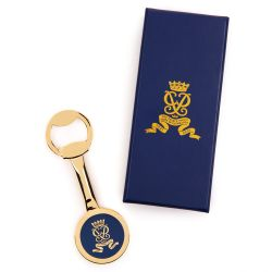 gold plated bottle opener featuring the Duke of Edinburgh cipher next to a navy presentation box