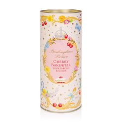 A cardboard tube of cherry bakewell biscuits. There is a floral garland at the top and bottom of the tube. At the centre of the tube is a pink oval reading the words 'Buckingham Palace' in gold and 'cherry bakewell shortbread rounds' in red. The oval is s