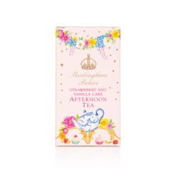Pink box decorated with gold stars, and floral garlands. At the bottom of the box is a design of florals, a floral teapot and cakes. At the centre of the box is a gold coronet the words Buckingham Palace in gold and 'strawberry and vanilla cake afternoon