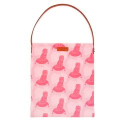 A light pink tote bag with a print of a pink dog with brown leather handle