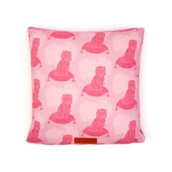 Square cushion made with material printed with pink dogs