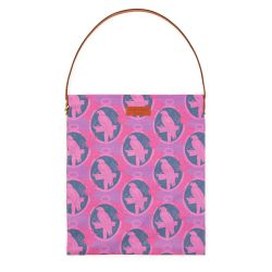 Tote bag with brown leather handle and brown leather tag saying 'Buckingham Palace' using material printed with purple parrots