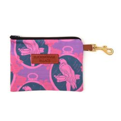 Pet treat pouch printed in a purple parrot print with a zip and a leather tag saying Buckingham Palace