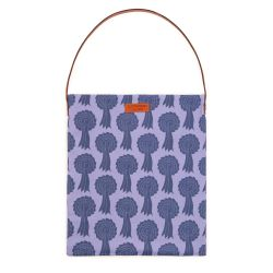 Tote bag with brown leather handle and brown leather tag saying 'Buckingham Palace'. Made using a material printed with blue rosettes