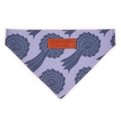 Pet bandana printed with a blue rosette print material. Finished with a leather tag saying 'Buckingham Palace'