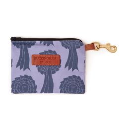 Pet treat pouch printed in a blue rosette print with a zip and a leather tag saying Buckingham Palace