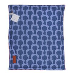 Square pet cushion made using a pale blue material printed with darker blue rosettes