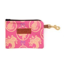 Pet treat pouch printed in a pink material printed with yellow and pink cats with a zip and a leather tag saying Buckingham Palace
