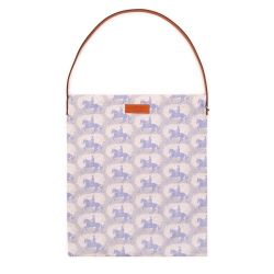 A tote bag printed with grey horses. It has a leather handle and a leather Buckingham Palace label