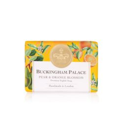bar of soap wrapped in yellow paper printed with oranges and pears. There is also a gold seal with a crown and a white box saying 'Buckingham Palace Pear and Orange Blossom Premium English Soap Handmade in London'