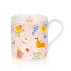 Pale pink mug decorated with corgis, yellow and blue florals, cakes, strawberries, butterflies and teacups. The pale pink background has gold stars and a gold coronet is printed on the inside of the mug.