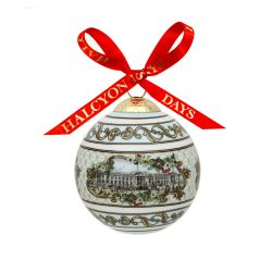 Fine bone English china bauble showing the facade of Buckingham Palace and tied with a red Halcyon Days ribbon
