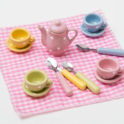 A rectangular tin displaying a tea set