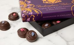 Buckingham Palace branded English rose and violet creams displayed in a ornate gift box and containing 17 individually wrapped chocolates.