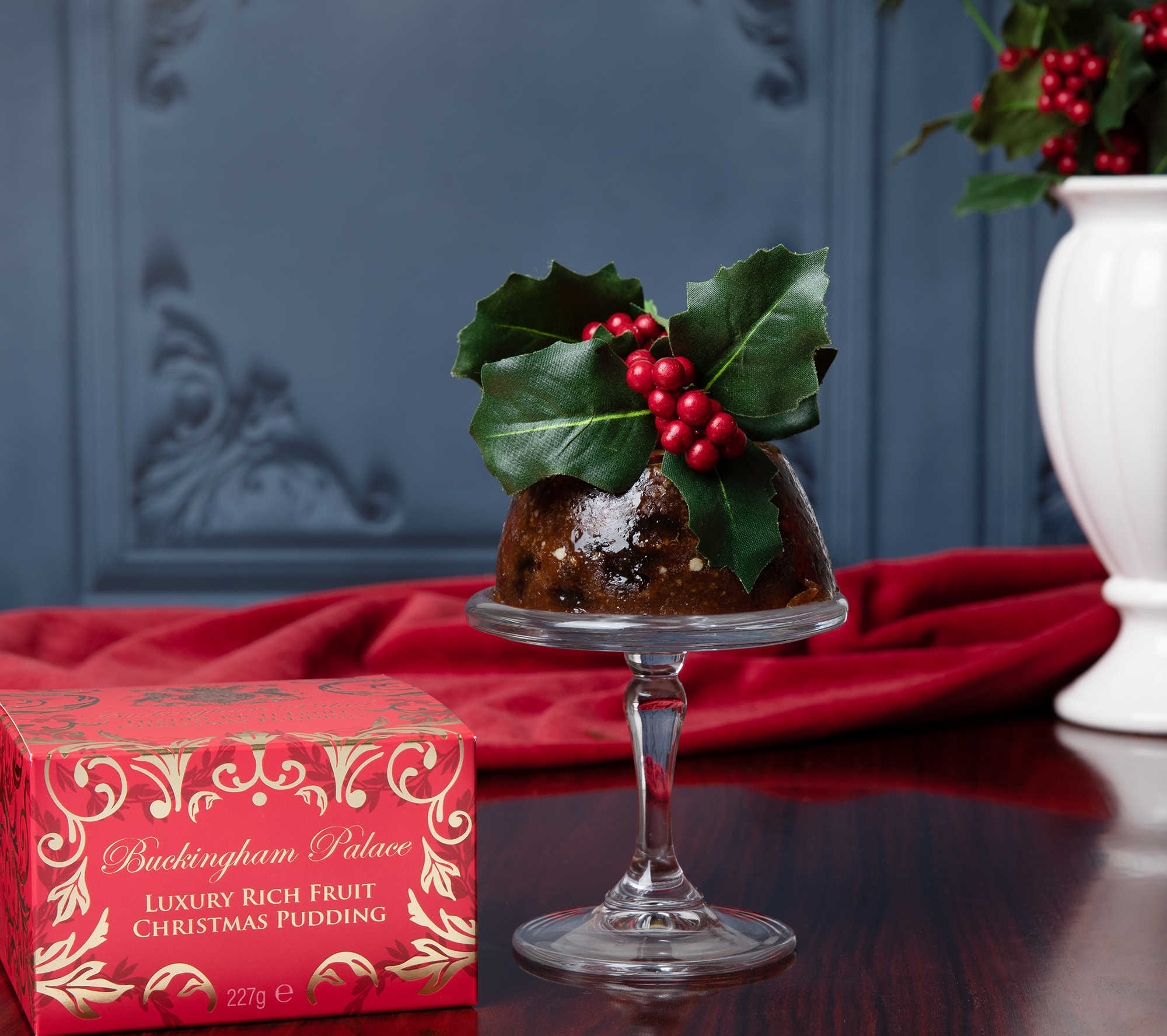 Luxury Christmas pudding with its festive red box