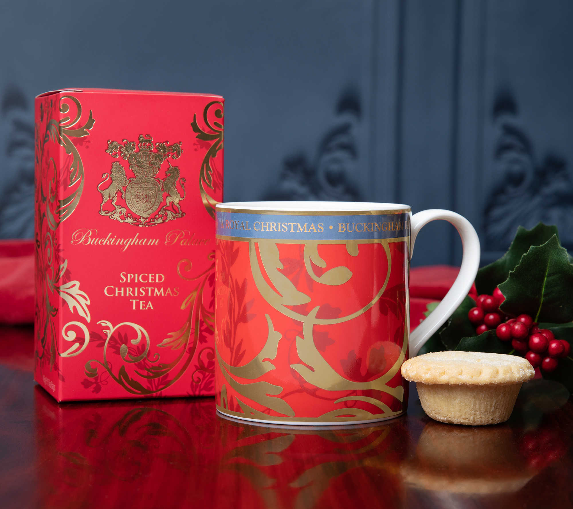 Mince pies and spiced tea with a sprig of holly